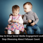 "Social media engagement concept shown with image of two toddlers sitting beside each other. Female toddler in flowered dress is looking down at her iPhone. Male toddler in taupe turtleneck and jeans is holding a black iPhone but he is looking over the other toddler's shoulder at her iPhone screen. He looks worried. Below the image is the headline ""How to Drive Social Media Engagement and Stop Obsessing About Follower Count"